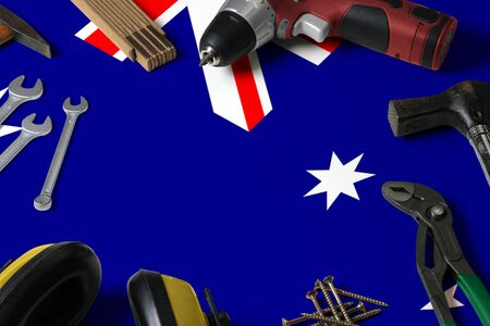 Australia flag on repair tool concept wooden table background. Mechanical service theme with national objects. Reklamní fotografie
