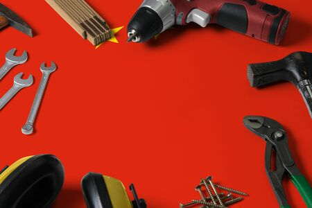 China flag on repair tool concept wooden table background. Mechanical service theme with national objects.