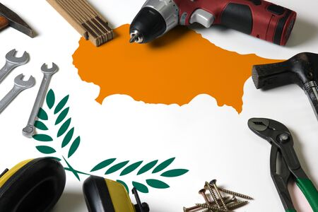 Cyprus flag on repair tool concept wooden table background. Mechanical service theme with national objects.