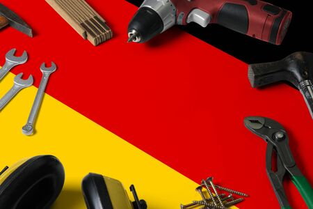 Germany flag on repair tool concept wooden table background. Mechanical service theme with national objects.
