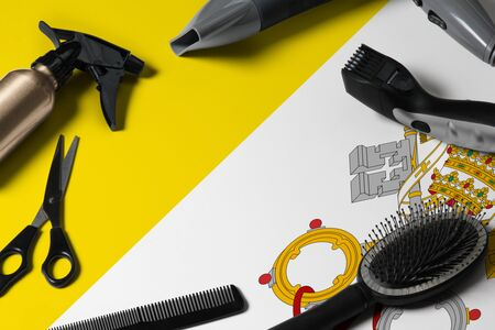 Vatican City flag with hair cutting tools. Combs, scissors and hairdressing tools in a beauty salon desktop on a national wooden background. Reklamní fotografie