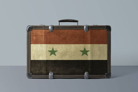 Syria flag on old vintage leather suitcase with national concept. Retro brown luggage with copy space text.