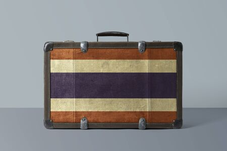 Thailand flag on old vintage leather suitcase with national concept. Retro brown luggage with copy space text. 免版税图像