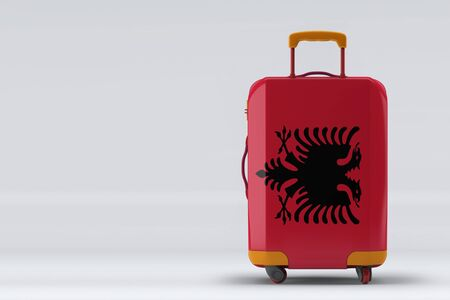 Albania flag on a stylish suitcases back view on color background. Space for text. International travel and tourism concept. 3D rendering.