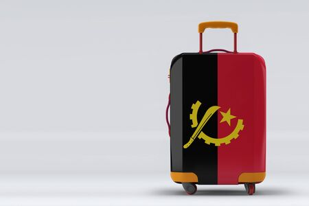 Angola flag on a stylish suitcases back view on color background. Space for text. International travel and tourism concept. 3D rendering.
