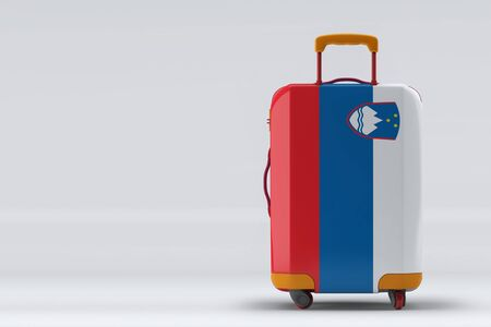 Slovenia flag on a stylish suitcases back view on color background. Space for text. International travel and tourism concept. 3D rendering.