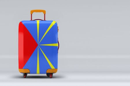 Reunion national flag on a stylish suitcases on color background. Space for text. International travel and tourism concept. 3D rendering.