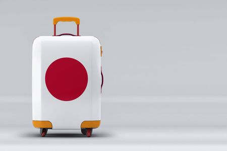 Japan national flag on a stylish suitcases on color background. Space for text. International travel and tourism concept. 3D rendering.