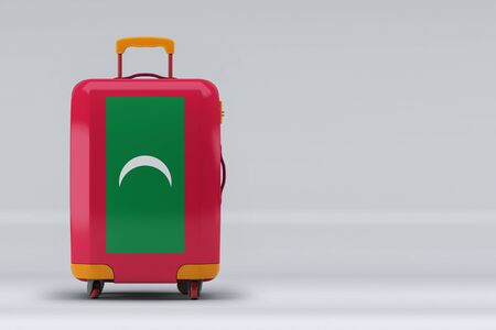 Maldives national flag on a stylish suitcases on color background. Space for text. International travel and tourism concept. 3D rendering.