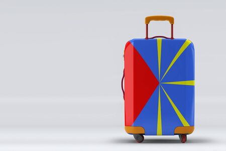 Reunion flag on a stylish suitcases back view on color background. Space for text. International travel and tourism concept. 3D rendering.