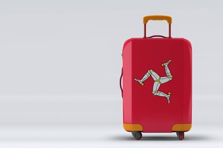 Isle Of Man flag on a stylish suitcases back view on color background. Space for text. International travel and tourism concept. 3D rendering.