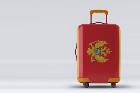 Montenegro flag on a stylish suitcases back view on color background. Space for text. International travel and tourism concept. 3D rendering.