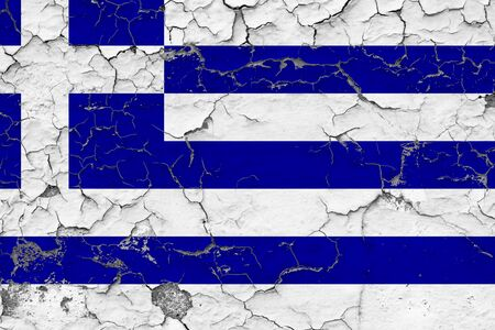 Greece flag close up grungy, damaged and weathered on wall peeling off paint to see inside surface. Vintage concept.