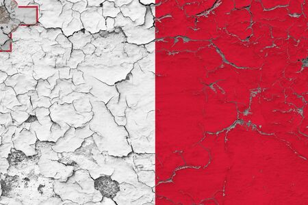 Malta flag close up grungy, damaged and weathered on wall peeling off paint to see inside surface. Vintage concept.