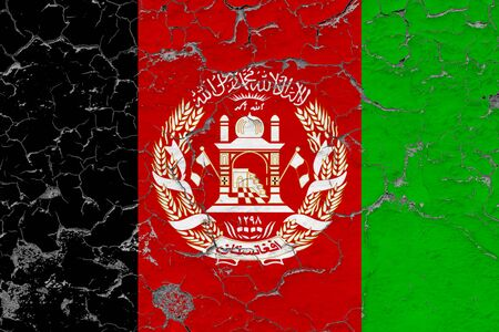 Afghanistan flag close up grungy, damaged and weathered on wall peeling off paint to see inside surface. Vintage concept.