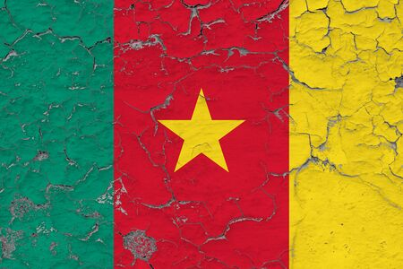 Cameroon flag close up grungy, damaged and weathered on wall peeling off paint to see inside surface. Vintage concept.