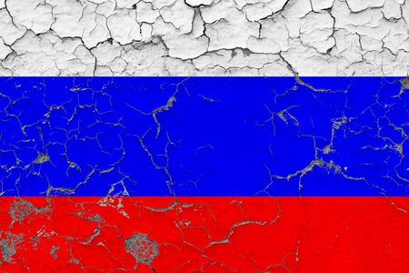 Russia flag close up grungy, damaged and weathered on wall peeling off paint to see inside surface. Vintage concept.