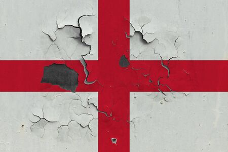 England flag close up old, damaged and dirty on wall peeling off paint to see inside surface. Vintage National Concept. Stockfoto