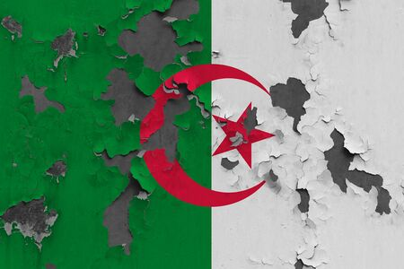 Algeria flag close up painted, damaged and dirty on wall peeling off paint to see concrete surface. Vintage National Concept. Stockfoto