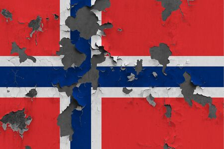 Norway flag close up painted, damaged and dirty on wall peeling off paint to see concrete surface. Vintage National Concept.