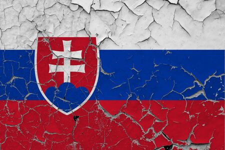 Slovakia flag close up grungy, damaged and scratched on wall peeling off paint to see inside surface. Vintage National Concept.