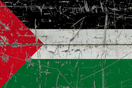 Palestine flag painted on cracked dirty surface. National pattern on vintage style surface. Scratched and weathered concept.