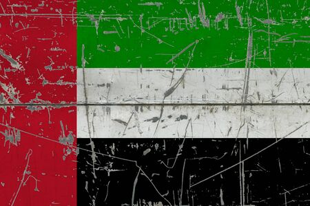 United Arab Emirates flag painted on cracked dirty surface. National pattern on vintage style surface. Scratched and weathered concept.