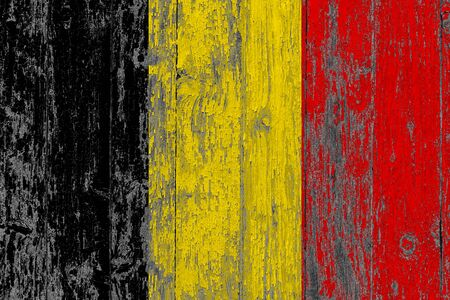 Belgium flag on grunge scratched wooden surface. National vintage background. Old wooden table scratched flag surface. 写真素材