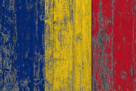 Romania flag on grunge scratched wooden surface. National vintage background. Old wooden table scratched flag surface.