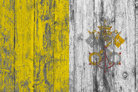 Vatican City flag on grunge scratched wooden surface. National vintage background. Old wooden table scratched flag surface.