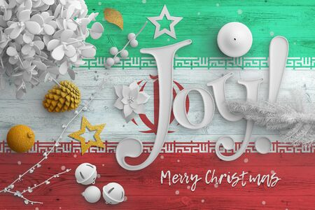 Iran flag on wooden table with joy text. Christmas and new year background, celebration national concept with white decor.