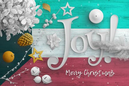 Kuwait flag on wooden table with joy text. Christmas and new year background, celebration national concept with white decor.