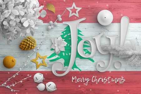 Lebanon flag on wooden table with joy text. Christmas and new year background, celebration national concept with white decor.