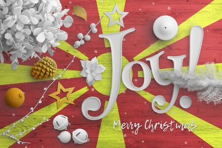 Macedonia flag on wooden table with joy text. Christmas and new year background, celebration national concept with white decor. Foto de archivo