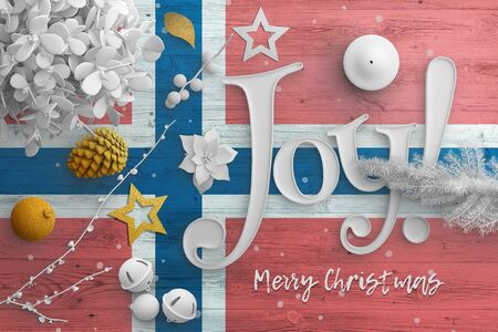 Norway flag on wooden table with joy text. Christmas and new year background, celebration national concept with white decor. Foto de archivo
