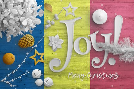 Romania flag on wooden table with joy text. Christmas and new year background, celebration national concept with white decor. Foto de archivo