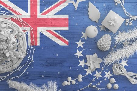 Cook Islands flag on wooden table with snow objects. Christmas and new year background, celebration national concept with white decor. Foto de archivo