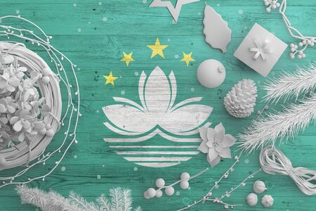Macao flag on wooden table with snow objects. Christmas and new year background, celebration national concept with white decor.