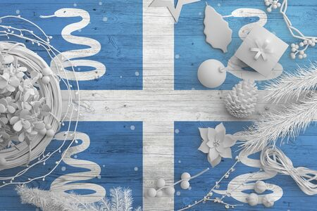 Martinique flag on wooden table with snow objects. Christmas and new year background, celebration national concept with white decor.