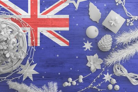 Australia flag on wooden table with snow objects. Christmas and new year background, celebration national concept with white decor. Foto de archivo