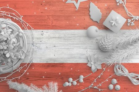 Austria flag on wooden table with snow objects. Christmas and new year background, celebration national concept with white decor.