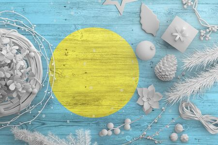 Palau flag on wooden table with snow objects. Christmas and new year background, celebration national concept with white decor. Foto de archivo