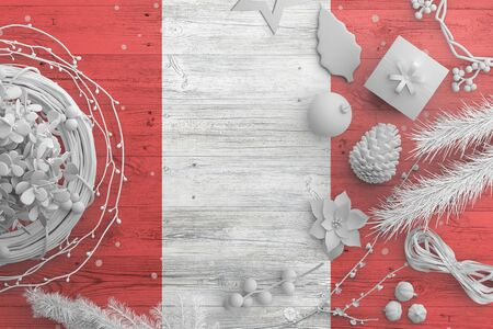 Peru flag on wooden table with snow objects. Christmas and new year background, celebration national concept with white decor.