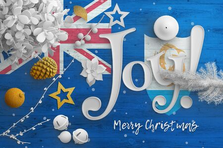 Anguilla flag on wooden table with joy text. Christmas and new year background, celebration national concept with white decor. Foto de archivo