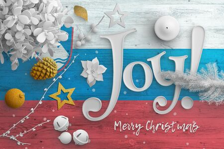 Slovenia flag on wooden table with joy text. Christmas and new year background, celebration national concept with white decor.