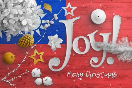 Taiwan flag on wooden table with joy text. Christmas and new year background, celebration national concept with white decor.