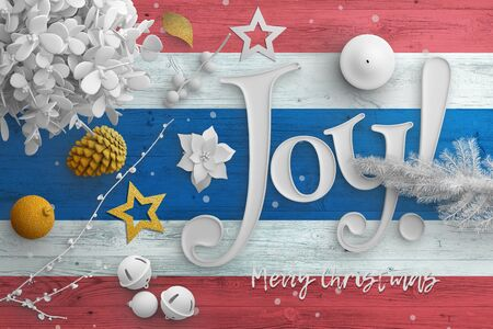 Thailand flag on wooden table with joy text. Christmas and new year background, celebration national concept with white decor. Foto de archivo