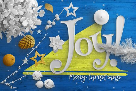 Tokelau flag on wooden table with joy text. Christmas and new year background, celebration national concept with white decor.
