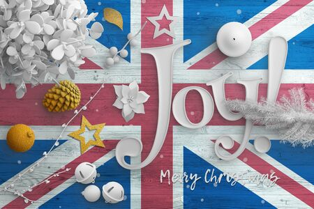 United Kingdom flag on wooden table with joy text. Christmas and new year background, celebration national concept with white decor.