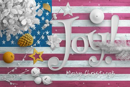 United States flag on wooden table with joy text. Christmas and new year background, celebration national concept with white decor.